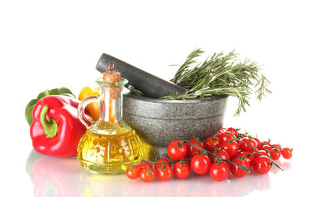 rosemary in mortar, oil in jar, paprika, tomatoes cherry, isolated on white photo