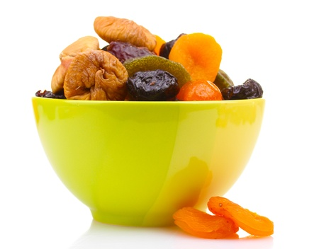 Dried fruits in green bowl isolated on white Stock Photo - 12564514