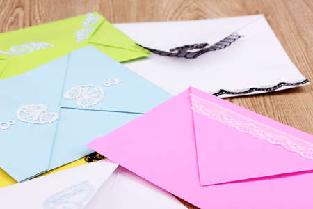 Bunch of color envelopes close-up on wooden background Stock Photo - 12564388