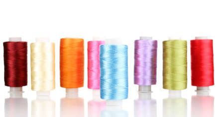 Many spools of thread isolated on white photo
