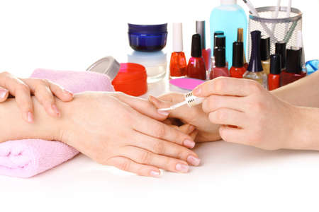 Manicure process in beautiful salon photo
