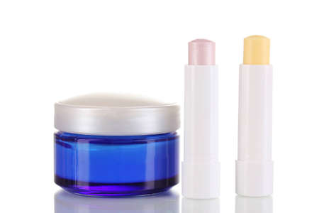 hygienic: Hygienic lipsticks and moisturizing cream isolated on white