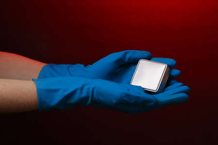 Uranium in hand on red background Stock Photo - 12564421