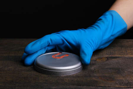 Uranium on wooden table isolated on black photo
