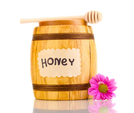 Sweet honey in barrel with drizzler isolated on white photo