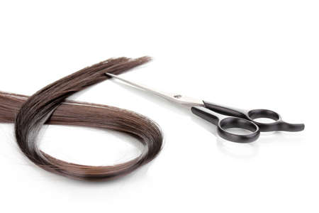 Shiny brown hair and hair cutting shears isolated on white Stock Photo - 12564511