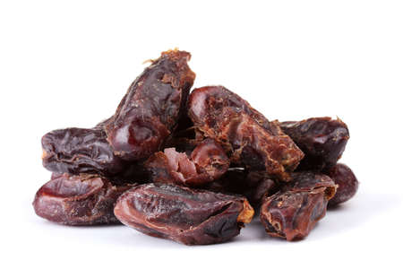 delicious dried dates isolated on white photo