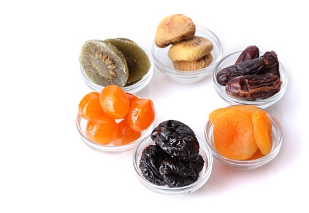 Dried fruits in bowls isolated on white Stock Photo - 12564257