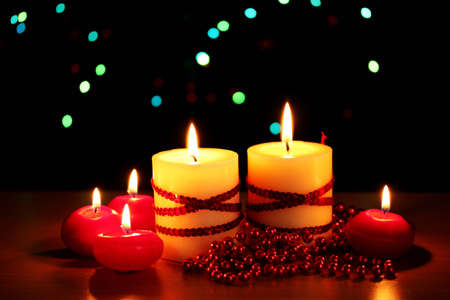 Beautiful candles and decor on wooden table on bright background photo