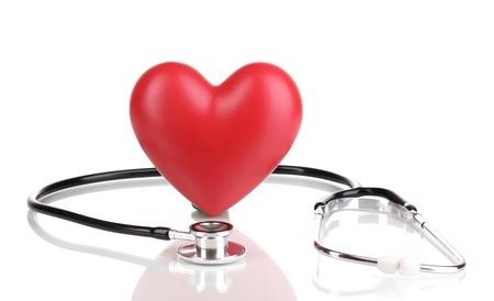 Stéthoscope médical et le c?ur isolé sur blanc Banque d'images