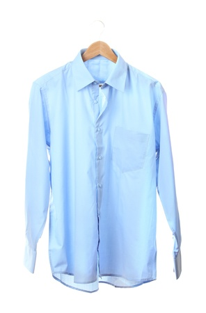 Blue shirt on wooden hanger isolated on white photo