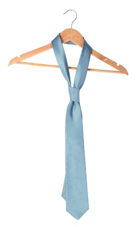 Blue tie on wooden hanger  isolated on white photo