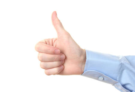 mans hand with thumb up ok signal isolated on white  photo