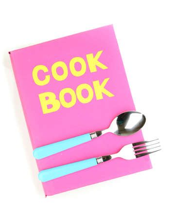 Pink cookbook and kitchenware isolated on white photo