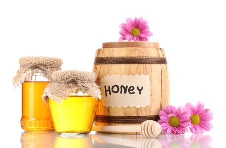 drizzler: Sweet honey in barrel and jars with drizzler isolated on white