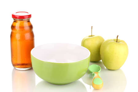 Baby plate and spoon with apple and juice isolated on white photo