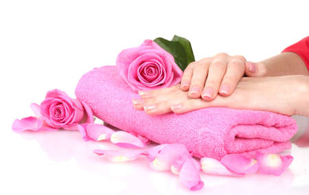 Pink towel with roses and hands on white background photo