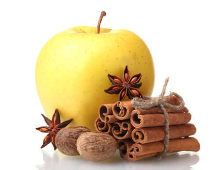 Cinnamon sticks, apple, nutmeg and anise isolated on white Stock Photo - 12664256