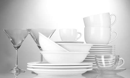 empty bowls, plates, cups and glasses on grey background Stock Photo - 12664269