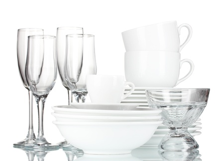 empty bowls, plates, cups and glasses on grey background photo