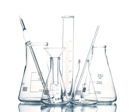 Empty laboratory glassware with reflection isolated on white photo