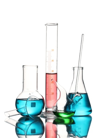 Different laboratory glassware with color liquid and with reflection isolated on white photo