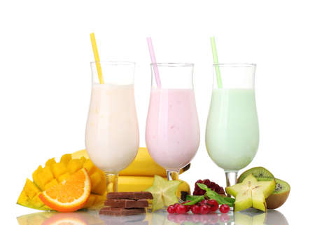 Milk shakes with fruits isolated on white photo