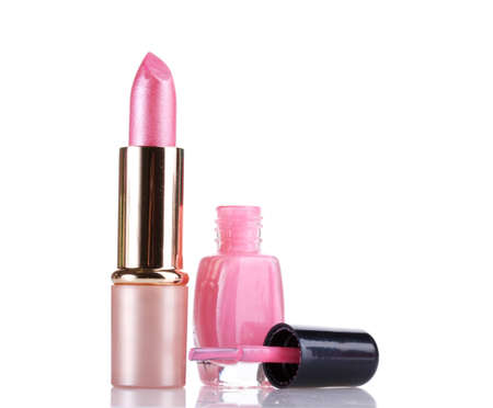 Pink lipstick and nail polish isolated on white photo