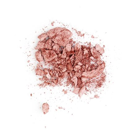 Crushed eyeshadows isolated on white photo