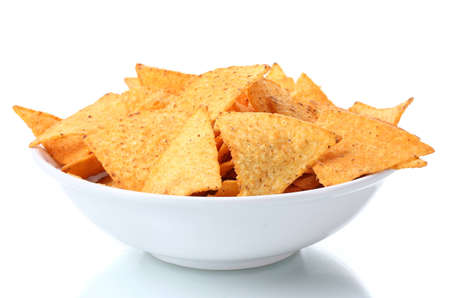 tasty potato chips in bowl isolated on white photo
