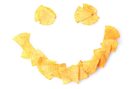 Delicious potato chips smile shape isolated on white photo