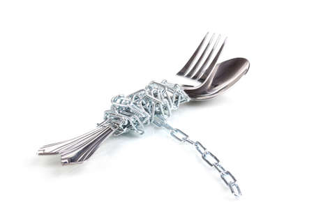 Fork and spoon with chain isolated on white photo