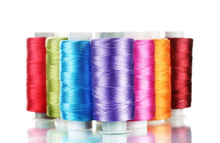 bright bobbin thread isolated on white  photo
