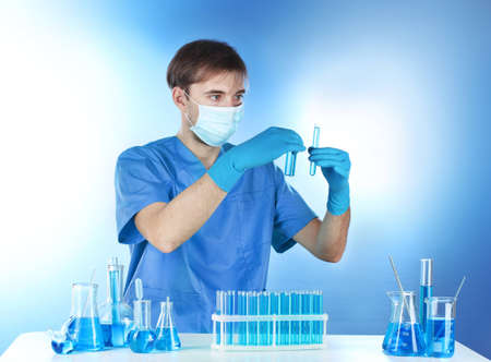 Scientist working with chemical test-tubes in lab Stock Photo - 12664584