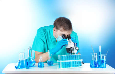 scientist in the lab working with microscope photo