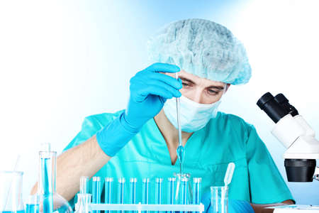 scientist in the lab working with chemicals test-tubes Stock Photo - 12664627