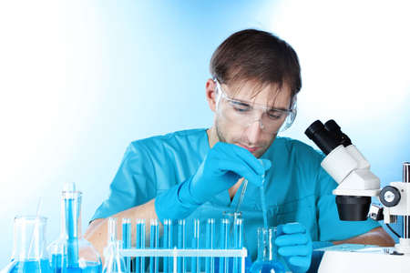 Scientist working with chemical test-tubes in lab Stock Photo - 12664791
