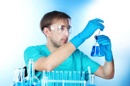 scientist in the lab working with chemicals test-tubes photo