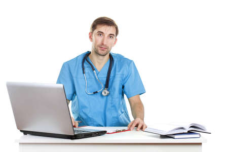 Young doctor working in office Stock Photo - 12664242