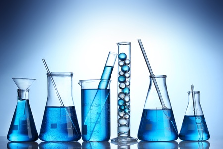 Test-tubes with blue liquid on blue background Stock Photo - 12664824