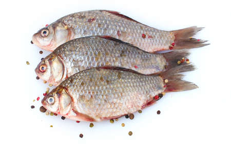 Fresh fishes with pepper isolated on white Stock Photo - 12664898