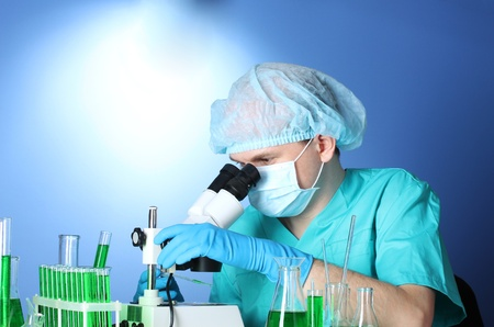 scientist looking at microscope in chemistry laboratory Stock Photo - 12664907