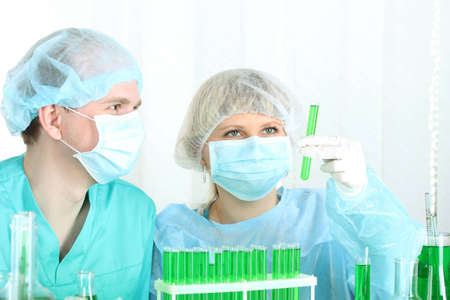 two scientists working in chemistry laboratory  photo