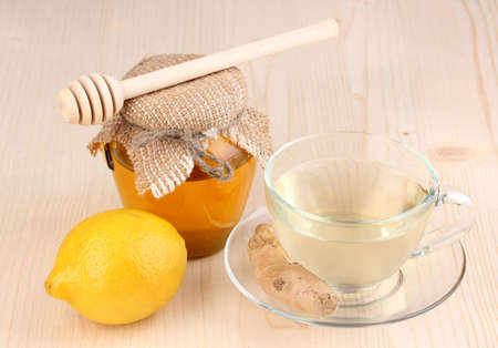 Healthy ginger tea with lemon and honey on wooden background Stock Photo - 12664811