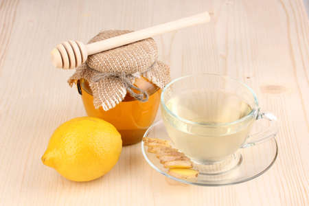 Healthy ginger tea with lemon and honey on wooden background Stock Photo - 12665298