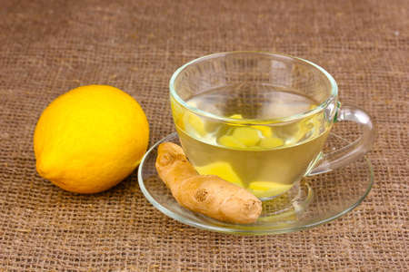 Healthy ginger tea with lemon on sackcloth photo