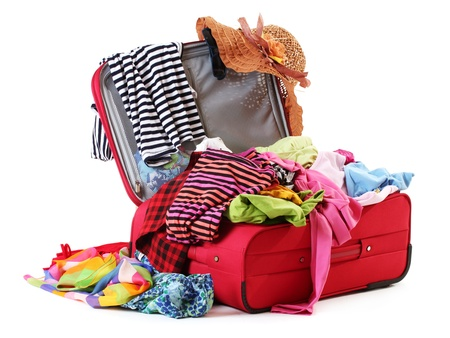 belongings: Open red suitcase with clothing isolated on a white Stock Photo