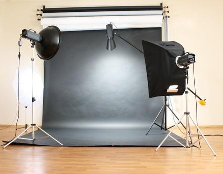 Studio flash on grey background photo