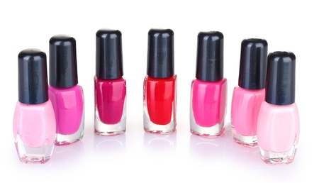 corall: Group of nail polishes isolated on white