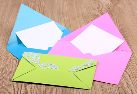 Color envelopes on wooden background Stock Photo - 12730848